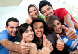 Group of students at the university with thumbs up